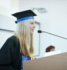 Female graduate delivering speech